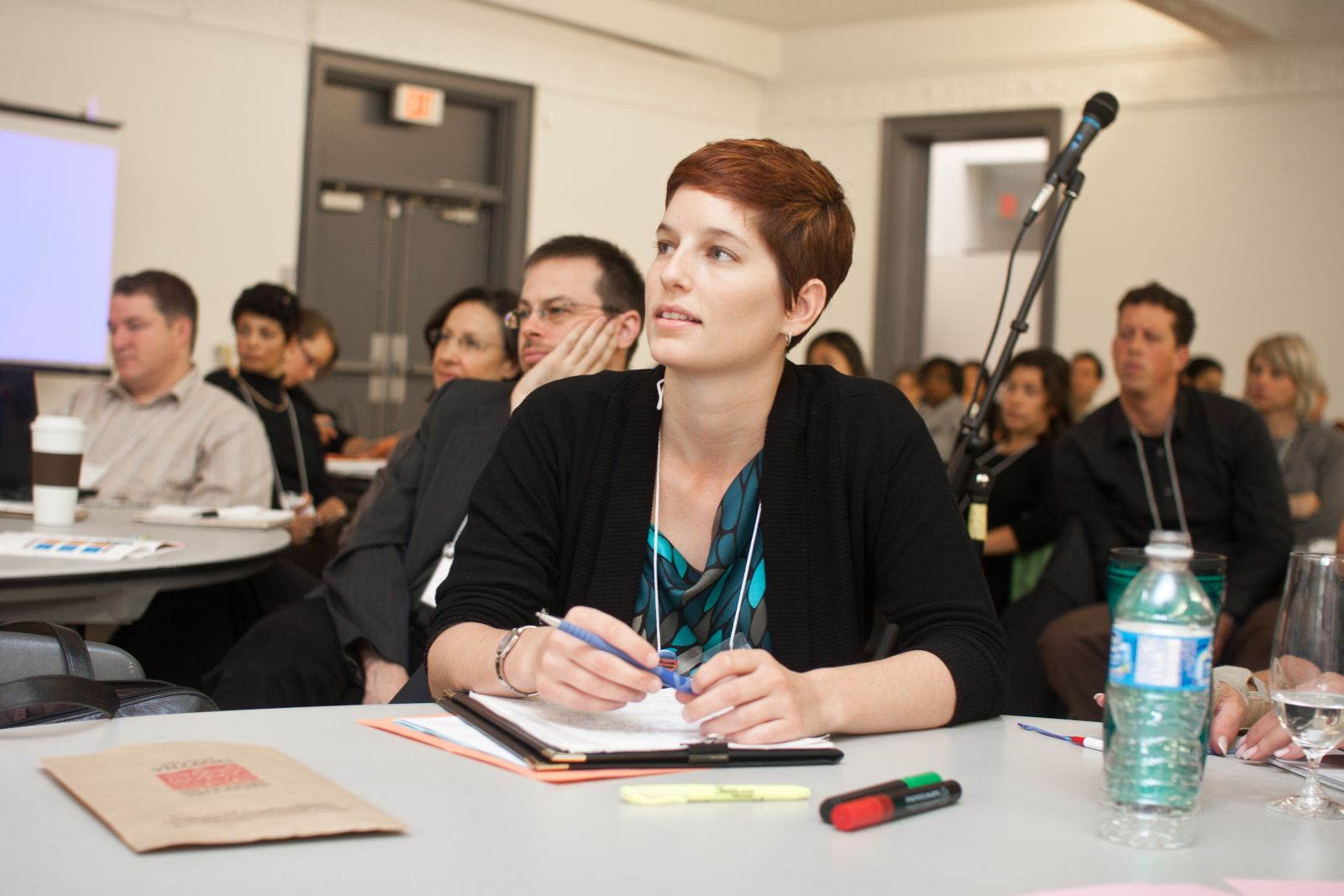 A female participant listens to a speaker (out of frame) at the OCIC GCF 2010.
