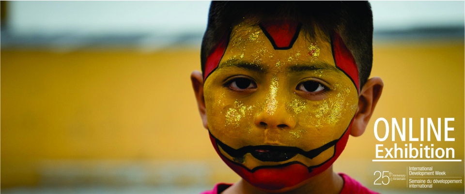 Boy with painted face.