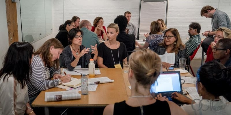 Group of individuals engaged in a workshop.