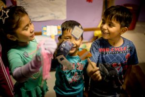Macia, Sebastian and Jose Luis present a puppet show about Children's Rights at a CODEHICA community centre program.
